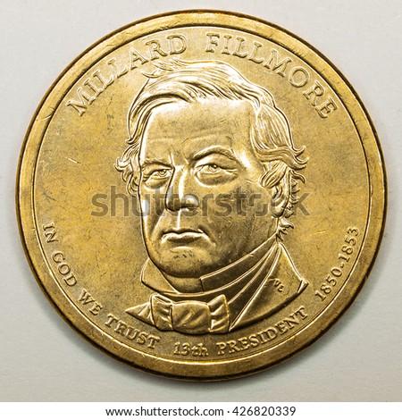 US Gold Presidential Dollar Featuring Millard Fillmore - stock photo