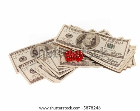 US high value currency and red dice on white background