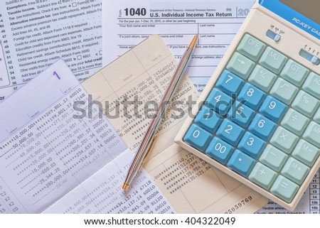 US Income tax return empty blank paper form for American residents with calculator, pen for writing fill in and bank book record background: USA national Tax day concept - stock photo