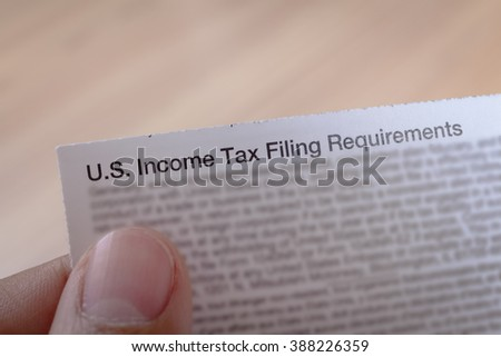 US incoming tax and hand for business concept background - stock photo