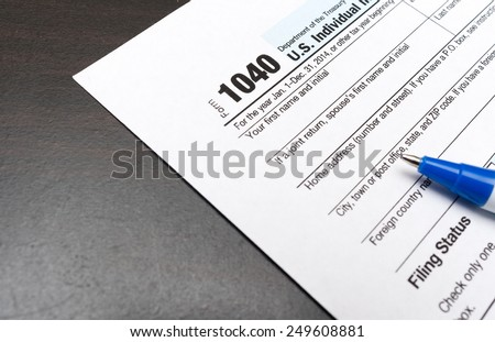 US Individual Tax Return Form 1040 and pen - stock photo