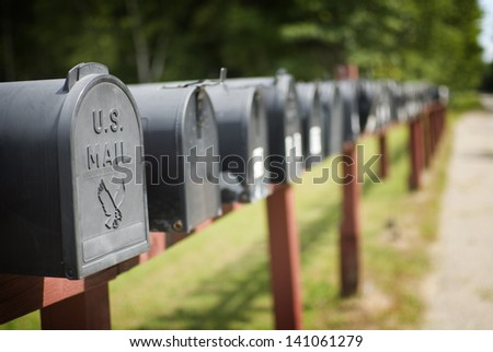 US Mailboxes in a row. - stock photo