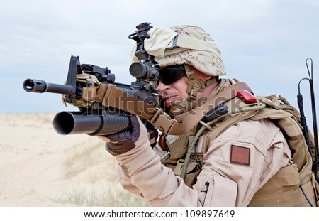 US marine aiming a gun with grenade launcher - stock photo