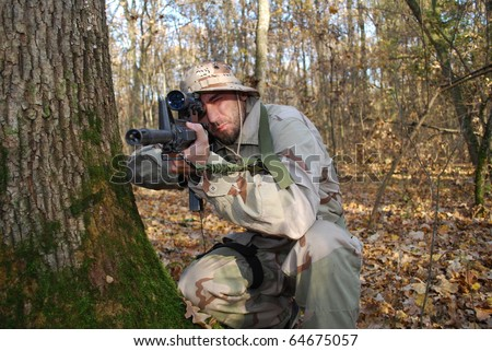 us marine in forest  aiming with sniper rifle - stock photo