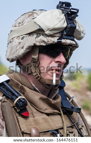 US marine smoking a cigarette half-turned to the camera - stock photo