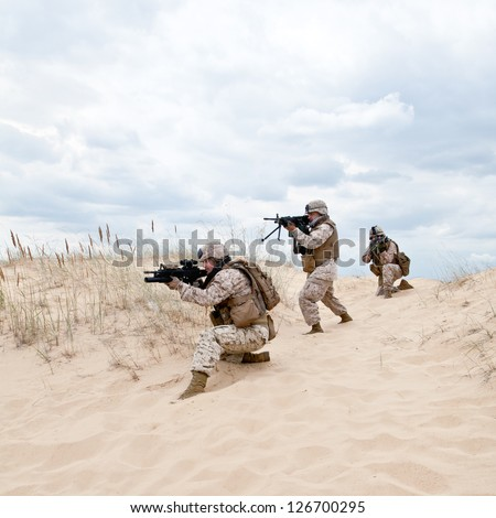 US marines run through the desert through the military operation - stock photo
