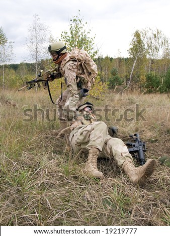 US Marines: soldier evacuating his wounded mate