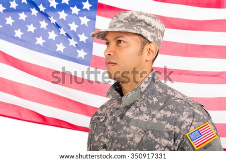 US military man standing in front of an american flag - stock photo