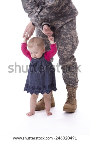 Us military mother teaching her child to walk on white background - stock photo