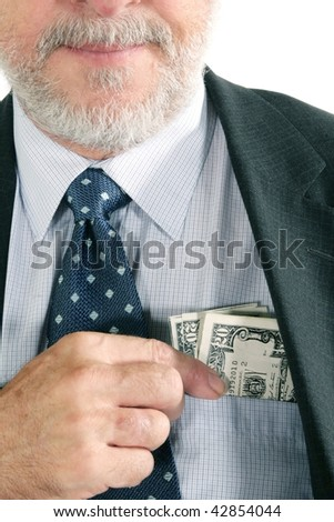 US money in a pocket of a business man - stock photo