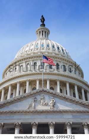 US national flag flying in front of US capitol Building in Washington DC - stock photo