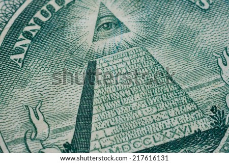 US one (1 ) dollar bill in a macro shot, super macro, close up photo. Shallow depth of field effect. Eye of Providence, all-seeing eye of God, Mason Illuminati Logo, Pyramid, Triangle. Great Seal. - stock photo