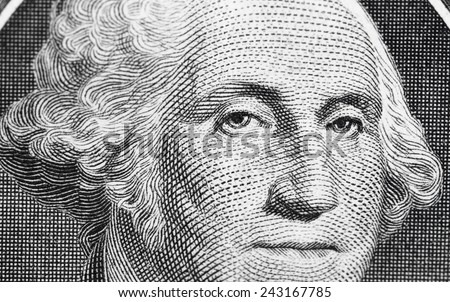 US one (1 ) dollar bill in a macro shot, super macro, close up photo. Shallow depth of field effect. George Washington portrait. - stock photo