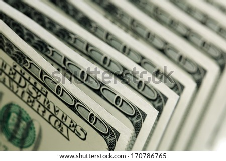 US paper currency one hundred dollar bills in a row - stock photo