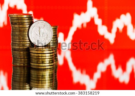 us quarter dollar coin and gold money. Fluctuating graph on red background. Rate of the american dollar (shallow DOF)  - stock photo