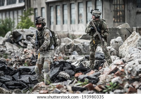 us rangers on patrol in destroyed city - stock photo