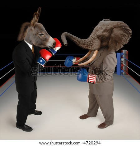 US Republican and Democrat mascots represented by a donkey and an elephant face off in a boxing ring in business suits with red white and blue boxing gloves. - stock photo