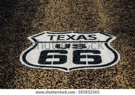 US Route 66 sign freshly painted on the highway in Vega, Texas - stock photo
