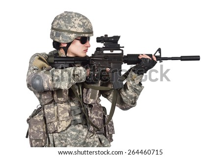 US soldier fires his rifle, close up - stock photo