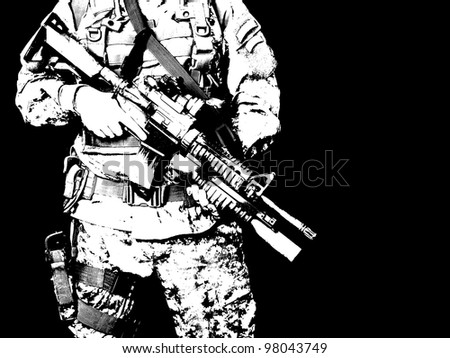 US soldier holding his assault rifle - stock photo