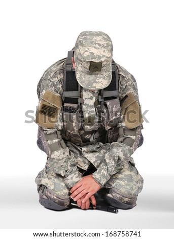 US soldier kneeling on white background - stock photo
