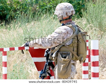 us soldier with assault rifle at the checkpoint - stock photo