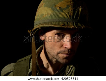 US Soldier With Face In Shadow - Vietnam War - stock photo