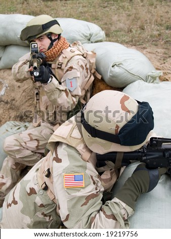 US soldiers on position fighting off the enemy