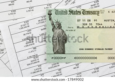 US stimulus refund check on spreadsheets. Numbers have been altered and names removed on check. - stock photo
