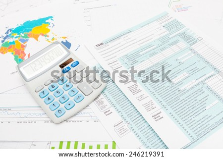 US 1040 Tax Form and calculator - stock photo