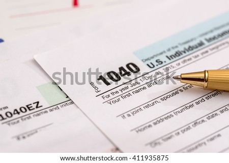 us 1040 tax form with calendar - stock photo
