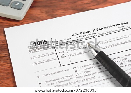 US tax form with pen and calculator selective focus / taxation concept