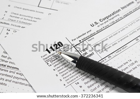 US tax form with pen selective focus / taxation concept