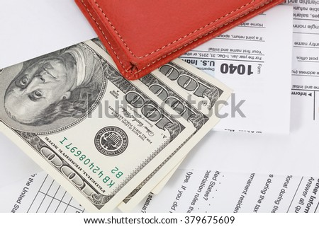 US tax form with wallet and money. Taxation concept