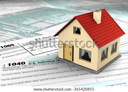 US tax forms and a miniature house symbolizing the savings or costs of owning real estate - stock photo