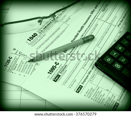 US tax forms (1040, 1120-C, 1095-C) - stock photo