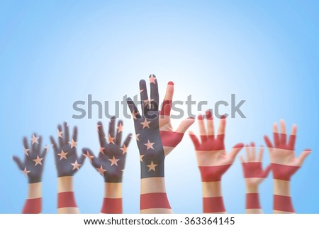 USA American flag pattern on people hand group against blue sky background: Many blur human open palms raising upward on air showing vote, volunteering, participation, election, civil rights concept - stock photo