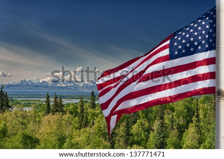 Usa American flag stars and stripes on mount McKinley Alaska background - stock photo