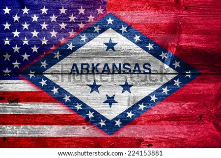 USA and Arkansas State Flag painted on old wood plank texture