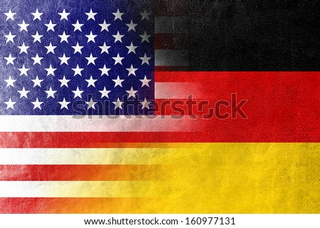 USA and Germany Flag painted on leather texture - stock photo
