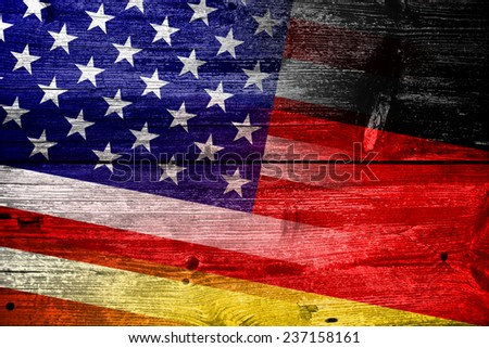 USA and Germany Flag painted on old wood plank texture - stock photo