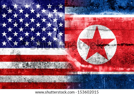 USA and North Korea Flag painted on grunge wall - stock photo