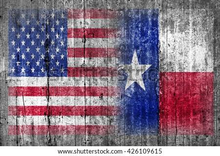 USA and Texas flag on concrete wall - stock photo