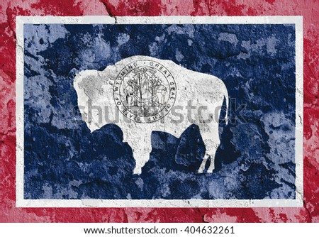 USA and Wyoming State Flag painted on grunge wall - stock photo