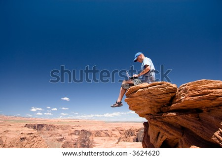 USA. Arizona. Page. Horseshoe Bend. Man with notebook - stock photo