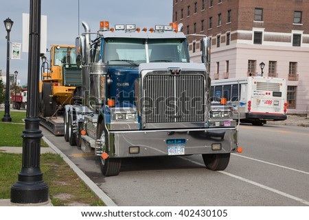 USA, BUFFALO - OCTOBER 21: Big towing truck in 2013 in the street. Frontal view.   - stock photo
