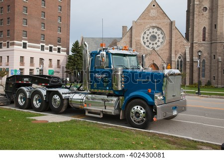 USA, BUFFALO - OCTOBER 21: Big towing truck in 2013 in the street. Side view.   - stock photo