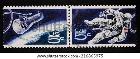 USA - CIRCA 1967:A Cancelled postage stamp from the USA illustrating American Astronaut walking in space, issued in 1967. - stock photo