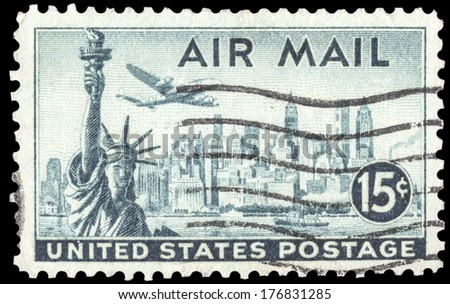 USA-CIRCA 1947: A 15 cent United States Airmail postage stamp, shows image a Lockheed Constellation airplane over New York Skyline and Statue of Liberty, circa 1947. - stock photo