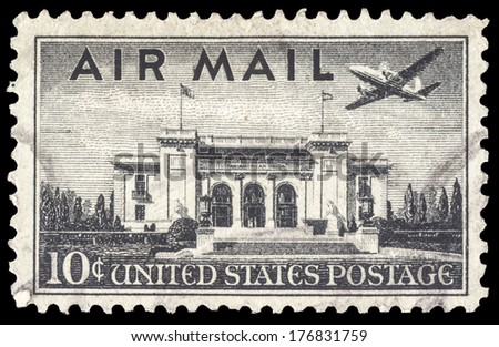 USA-CIRCA 1947: A 10 cent United States Airmail postage stamp, shows image a Martin 202 plane over Pan American Union Building, Washington DC, circa 1947 - stock photo